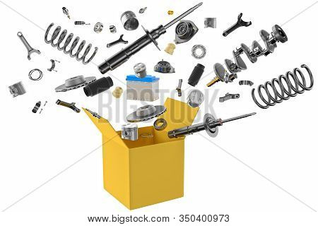 Many Spare Parts Flying Out Of The Box Gray Background. Isolated Auto Spare Parts On Gray Background