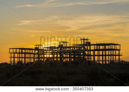 Backlit Image Of Building Construction Site Work From Concrete, Concrete Structure Of Building Under