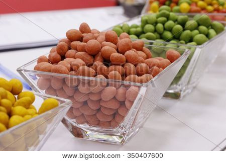 Peanuts In Glaze Curry, Wasabi And Chili. A Selection Of Nuts On A Table In A Vase. Peanuts In Wasab