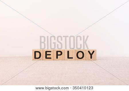 Deploy Word Written On Wooden Cubes On A White Background.