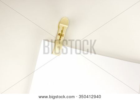 Plastic Clothespin And Blank Paper On White Background. Close Up Of Blank Paper With Plastic Clothes