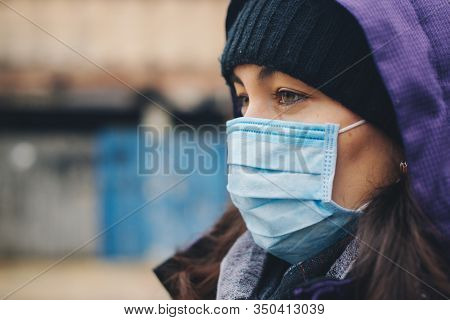 Woman Wears Protective Mask Outdoor. Mask Against Infectious Diseases And Flu. Health Care Concept.