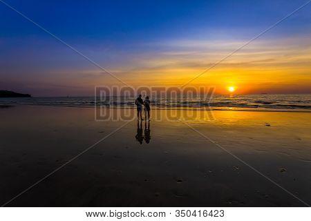 Ko Lanta, Kabi, Thailand,31,jun,2020,women And Men Stand Watching The Sunset At The Sea On Ko Lanta,