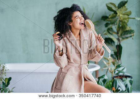 Vivacious Emotional Multi Ethnic Woman With Curly Hair In Bathroom, Morning Routine At Home, Being I