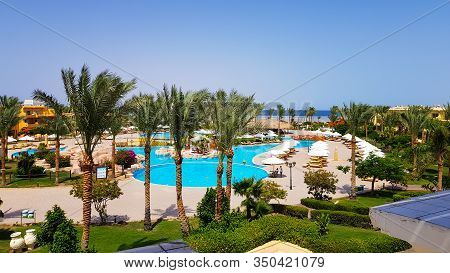 Sharm El Sheikh, Egypt - July 13, 2019: Main Pool And Amway Territory. Luxurious Hotel Grounds. Land