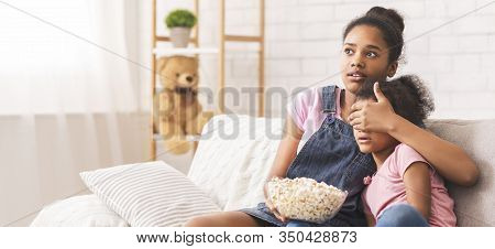 Adult Tv Movie. Shocked African Teen Girl Closing Her Little Sisters Eyes, Panorama, Empty Space