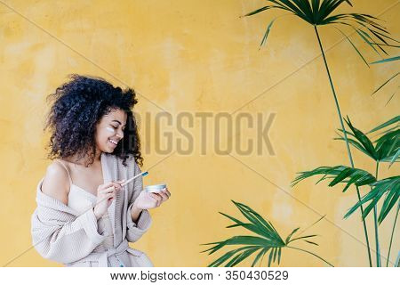 Young Friendliness African American Woman Dressing Beige Gown Using Eco-friendly Bamboo Toothbrush A