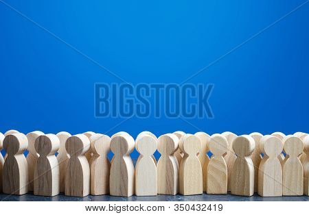 A Crowd Of Wooden Figures Of People. Customers And Buyers, Statistics, Preferences Of Population. Gr