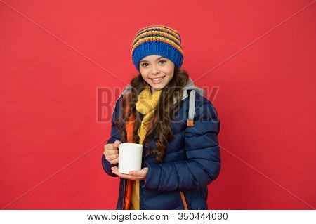 Time To Get Energy. Happy Child Enjoy Hot Drink On Winter Day. Small Girl Hold Tea Or Cocoa Cup Red