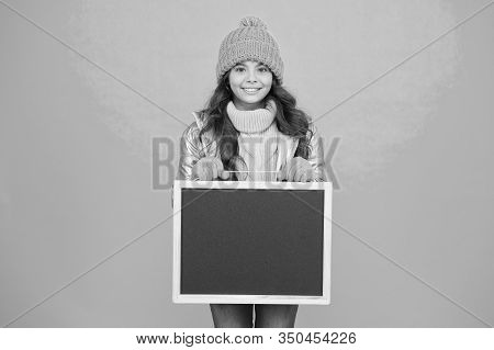 Promoting Product. Child Promoting Event. Promotion Concept. Kid Cheerful Promoting. Smiling Girl We