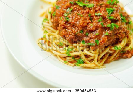 Minced Beef Bolognese With Onions And Carrots Served With Spaghetti