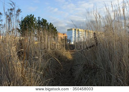 Urbanization. Demolition Of Old Houses In Order To Build New Structures In Their Place. The City Is