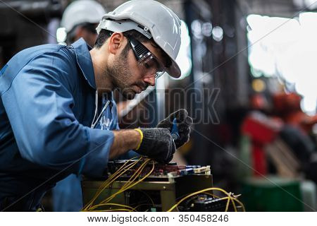 Engineer Manual Workers Standing In A Aluminum Mill And Working Together. Used Professional Equipmen