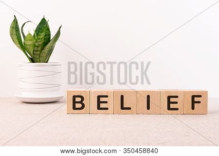 Belief Word Concept On A Light Table With Cubes And A Light Background