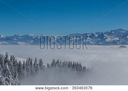 View To Swiss Alps From Rigi Mountain In Winter During High Inversion Fog, Blue Sky