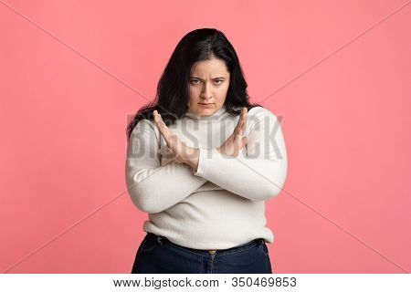 No Weight Discrimination Concept. Serious Plump Woman Making Denial Gesture, Keeping Hands Crossed O
