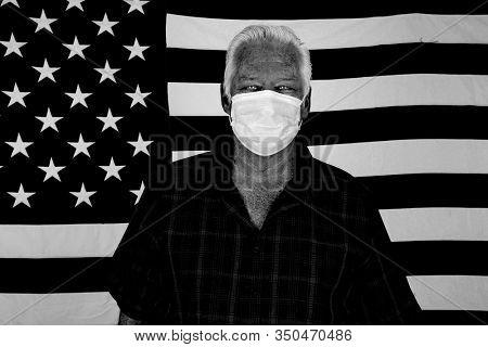2019 Novel Coronavirus. 2019-nCoV. Wuhan, China 2019 Novel Coronavirus. A Caucasian Man wearing a paper mask is scared of contracting the CORONAVIRUS. Room for text. Black & White.