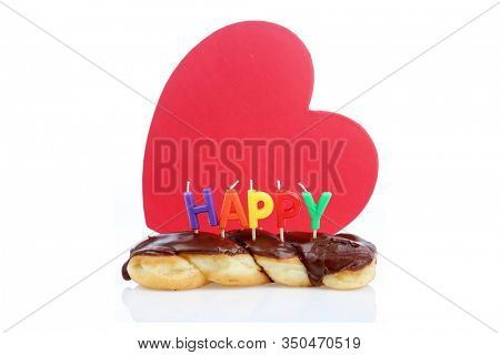 Birthday Donut. Cream Filled Chocolate Twisted Donut with a Red Heart. Isolated on white. Room for text. Birthday Donut for someone special. Twisted Chocolate Donuts and Hearts for a special party.
