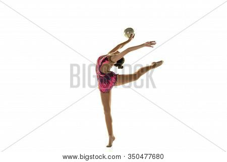 Young Flexible Girl Isolated On White Studio Background. Teen-age Female Model As A Rhythmic Gymnast