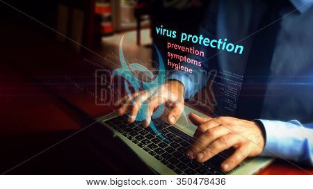Man Typing On Laptop With Virus Protection Hologram Screen Over Keyboard. Concept Of Searching Infor