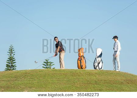 Group Golfer Sport Course Golf Ball Fairway.  People Lifestyle Playing Game Golf Tee Of On The Green