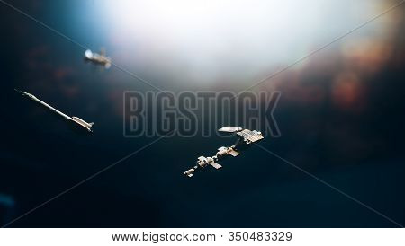 Space Satellite Orbiting The Blue Planet. Decorations For Photo Sattelite. Selected Focus