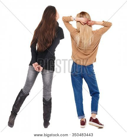 Back view of two woman in sweater. beautiful friendly girl and guy together. Rear view people collection. backside view of person. Isolated over white background.