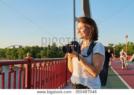 Mature Woman Photographer With Camera Taking Photo Picture. Female Blogger, Freelancer Working With