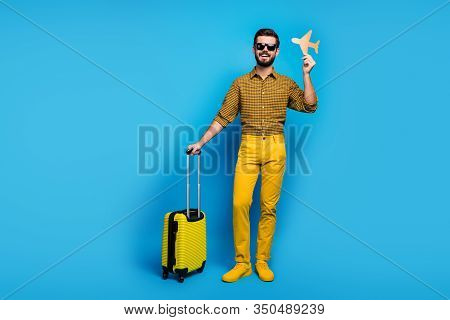 Full Body Photo Positive Bearded Man Enjoy Tourism Weekends Hold Orange Papercard Plane Trolley Trav
