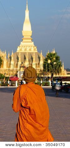 The  national monument in Laos Pha That Luang in Vientiane is the Great Stupa Great Sacred Reliquary,  a symbol of both the Buddhist religion and Lao sovereignty. poster