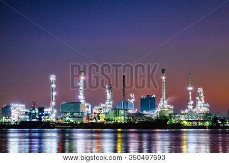 Oil And Gas Refinery Industry Plant With Glitter Lighting And Sunrise In The Morning, Factory Of Pet