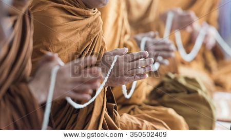 Buddhist Monk Praying Hands In Buddhism Tradition Ceremony.