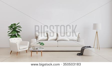 Stylish Interior Of Bright Living Room With White Sofa And Armchair, Floor Lamp, Plant And Coffee Ta