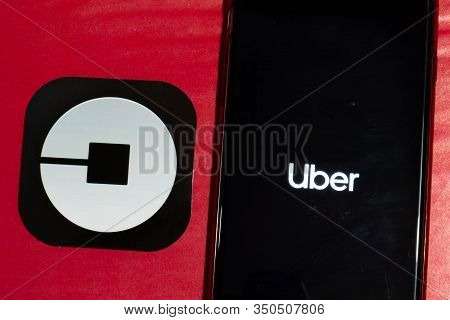 Los Angeles, California, Usa - 12 February 2020: Uber App Logo And Phone With Icon Close Up , Illust