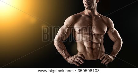 Unrecognizable Strong Athletic Sexy Muscular Man On Black Background.