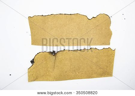 Burnt Pieces Of Vintage Paper Can Be Used In Design. Old Paper With Burnt Edges On White Background.