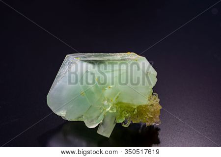 Green crystalline minerals on a black background
