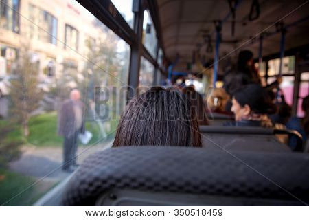 Bus In Selective Focus And Blurred Background. S The Main Mass Transit Passengers In The Bus. People