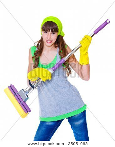 Angry teenage girl holding mop in hands