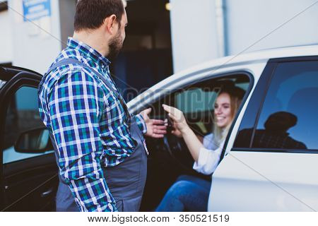 Car Service Worker Taking Car Keys Of Woman For Providing Technical Assistance Of Car
