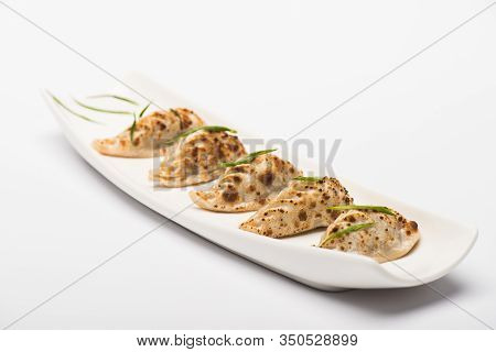 Delicious Gyoza Served On Plate On White Background