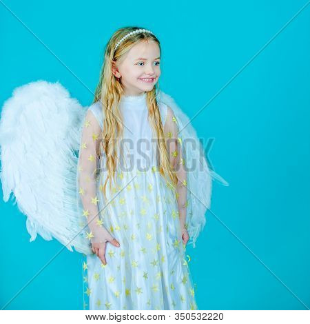 Little Angel Girl In White Dress With Angel Wings On Isolated Background. Christmas Cute Little Ange