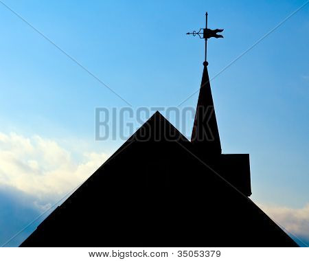 Silhouette of roof of historic building with weather vane in Huntsville, Alabama