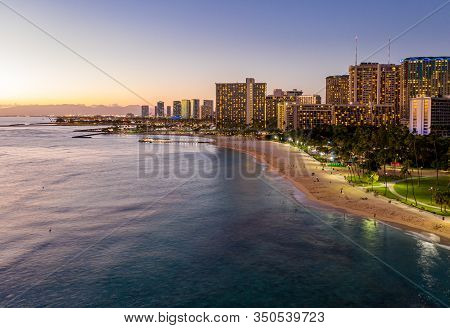 Aerial Panorama Of Waikiki Beach And Honolulu On Oahu, Hawaii At Sunset