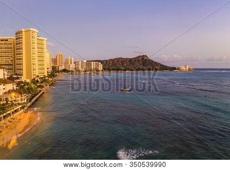 Aerial Panorama Of Waikiki Beach And Diamond Head On Oahu, Hawaii At Sunset