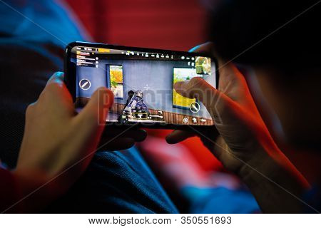 Moscow, Russia - December 2019: Back View Of A Close Up Of A Woman Hands Playing Online Game On A Sm