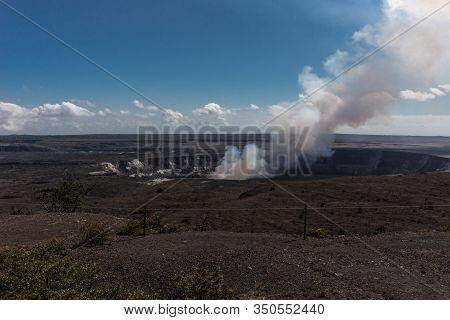 Kilauea Volcano, Hawaii, Usa. - January 9, 2012: View On Kalemaumau Crater Producing White-brown Thi