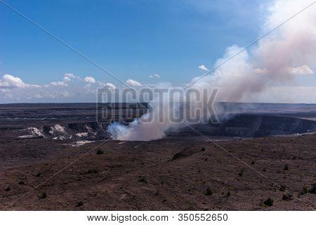 Kilauea Volcano, Hawaii, Usa. - January 9, 2012: View On Full Circle Kalemaumau Crater Producing Whi