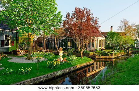 Old Dutch House Reflecting In Water