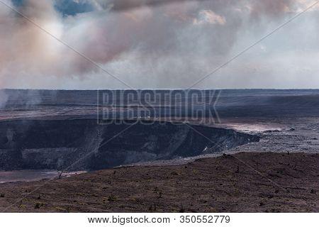 Kilauea Volcano, Hawaii, Usa. - January 9, 2012: Brown-white Thick Flume Hangs Over Kalemaumau Crate